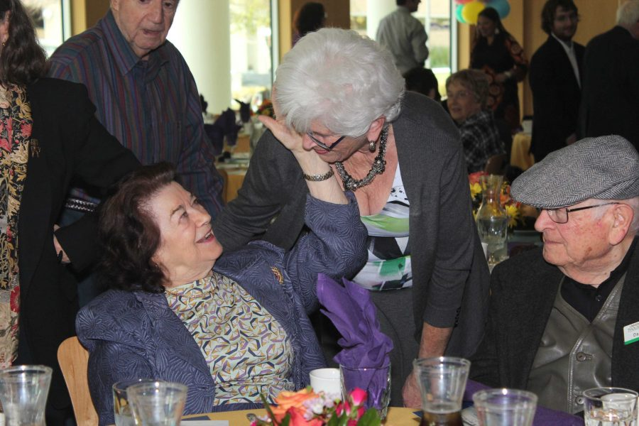Celebrating Life and Liberation: (L to R) Clara Knopfler and Joan Wine. Knopfler and Wine share a close conversation. Photo by Morgan Mantilla- Staff Photographer