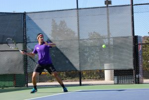 Swinging through: Cal Lutheran's Dara Kashani delivers back against Cerritos College Jan. 28. Cerritos defeated CLU 8-1. Photo by P.K. Duncan--Staff Photographer