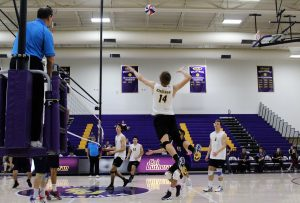 Flying high: 14 Mason Mercer goes up for a kill against Hope International Feb. 16. Photo Credit--Adrian Francis Staff Photographer