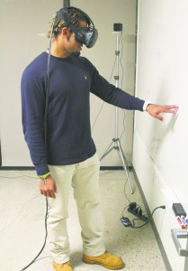 Senior Nathaniel Thompson tests out Emblematic Group's virtual reality technology. The company recently worked on a prison documentary and virtually placed Thompson in a solitary confinement cell.