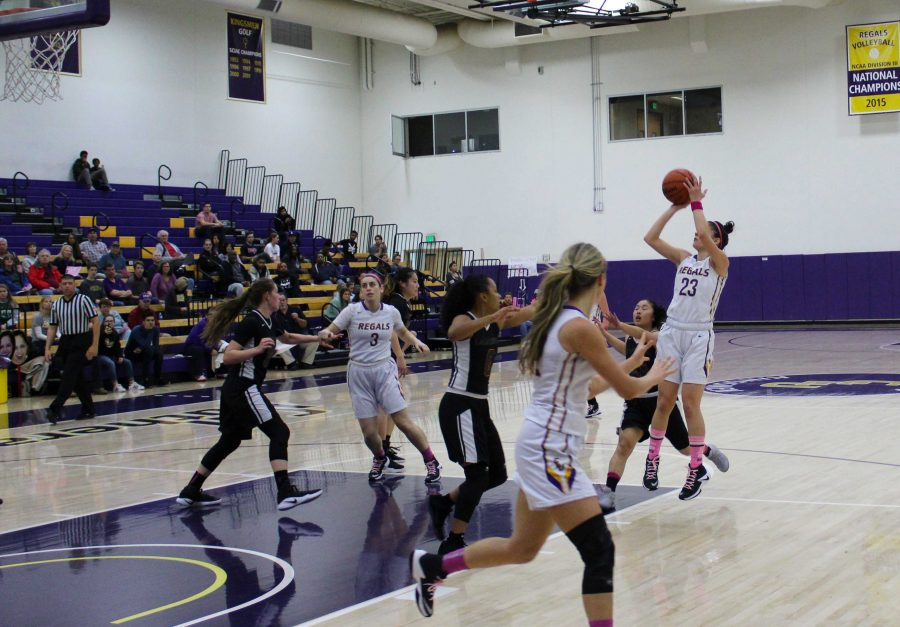 Draining shots: (L to R) (3) Makenna Murray, (32) Katy Lindor and (23) Sophia Cruz. The Regals powered past the Leopards with a 36-point victory Feb. 18. Cruz came away with four steals and eight points in the Regals win.  Photo by Adrian Francis--Staff Photographer