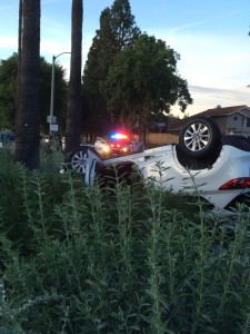 The white Mazda CX-5 flipped after colliding with a Kia Optima.  Photo by Dakota Allen, Staff Writer