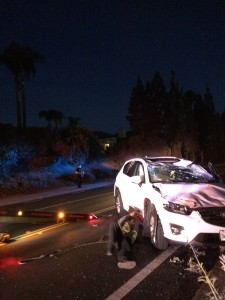 The white Mazda CX-5 after it has been righted by tow truck operators. Photo by Dakota Allen, Staff Writer