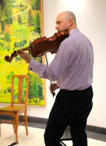 Perfectly in key: Alexander Gurevich, former member of the Florida Philharmonic, plays String Trio in B flat major, D 471 by Franz Schubert on the viola to open up the string trio concert in the William Rolland Gallery of Fine Art March 11.