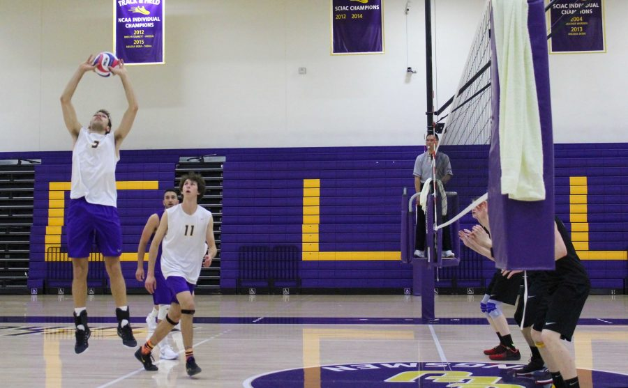 Spiked: (3) Nick Shoemate goes to set (11) Justin Dietrich to smash a kill on the opponent's court, helping the Kingsmen win 2 out of 3.  Photo by Adrian Francis--Staff Photographer