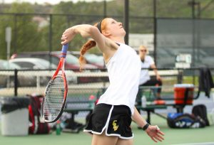 Backswing: Sophomore Sarah Seeman won her singles match and doubles match with junior Gianna Cupo against Valparaiso. Photo by Mary Crocker--Staff Photographer