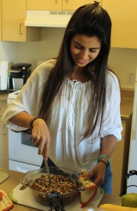Monica Echeverri prepares her pear bread to serve to her roommates. Photo by Mary Crocker -  Staff Photographer