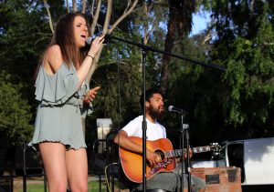"Michaela Kennedy (L) performs an original song called ""Just Enough"" with guitarist William De Leon (R)"