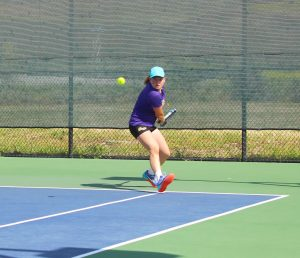 Senior salute: Senior Emily Werman with the help of sophomore Christie Kurdys were victorious in their doubles match 8-6, notching a point in the win for the Regals. Photo by Adrian Francis--Staff Photographer