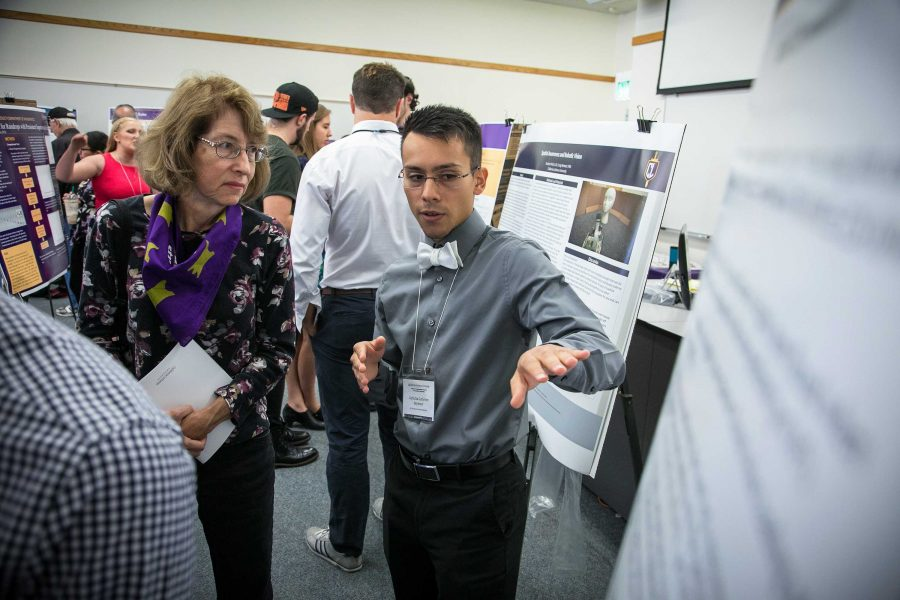 Cal Lutheran junior Gubidxa Gutierrez talks about his research project poster board. Photo provided by Brian Stetham.