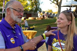 Alumni Karsten Lundring '65 (left) and Hayley Wolvseth '09 (right) mingle at the homecoming festival. Photo by Aliyah Navarro - Photojournalist