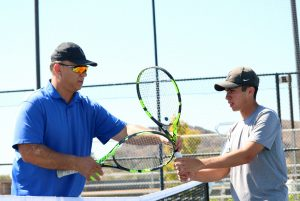 Head Coach Mike Gennette coaches both the men's and women's tennis teams at Cal Lutheran. Sebastian Ariza (right) hopes to improve upon his four wins in singles during his freshmen campaign. Photo by Inga Parkel- Photojournalist