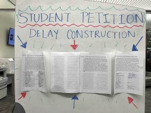 Student petition posted in library entrance. Photo by Taylor Rowlands - Editor in Chief