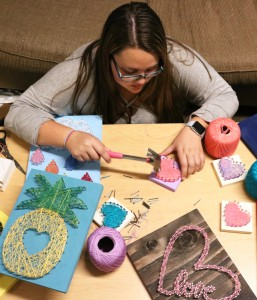"The hustle: Senior Victoria Lahney said there was ""an overwhelming amount of interest"" in her string art designs.  Photo by Inga Parkel - Photojournalist"