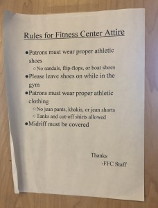Modest is hottest: The dress code policy of the Forrest Fitness Center is posted on the front entrance door. Photo by Aliyah Navarro- Photojournalist