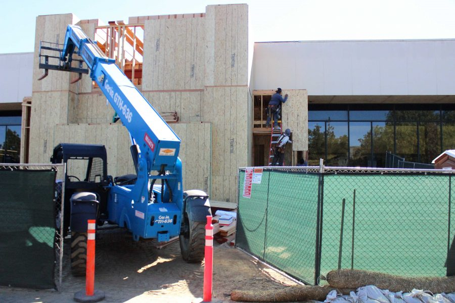 The Gallegly Center addition to the Pearson Library has recently gone from a basic frame to a structure with walls. Construction was halted late fall semester and resumed Dec. 18.