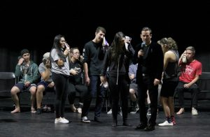 Hello, it's me: Students who volunteered to be hypnotized at the show Friday night were told that their shoes were phones and were ringing, so they must pick up.  Photo by Rachel Holroyd- Photojournalist