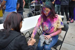 Cal Lutheran student Nicole Ishii has henna painted on her hand. Photo by Natalie Elliott- Photojournalist