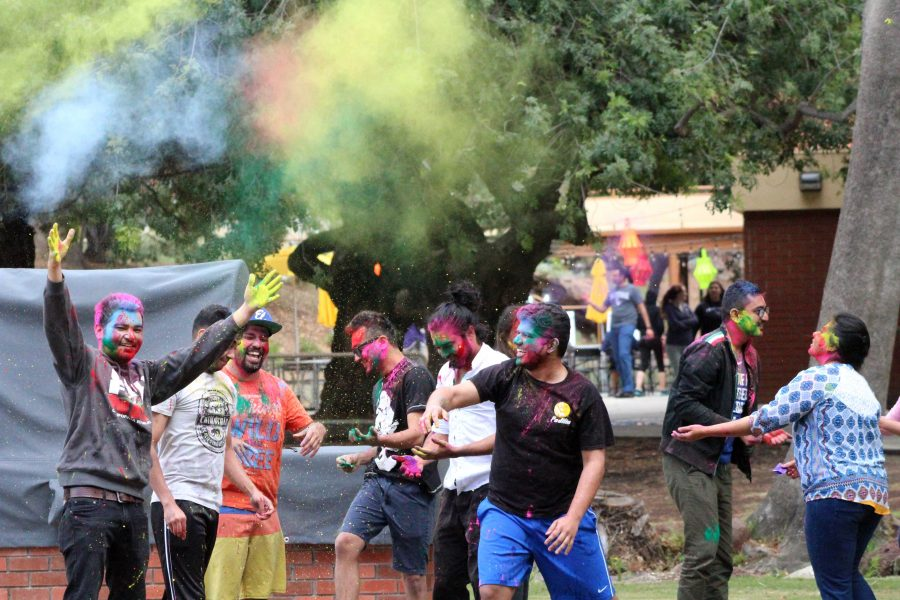 It's a colorful life: Students take part in the second component of the Holi Festival known as Rangwali Holi, which involves throwing powdered colors. In the process, appearances fade and everyone becomes equal.  Photo by Saoud Albuanain- Photojournalist