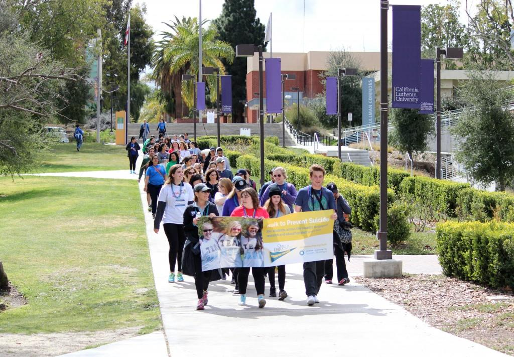 "Light in the darkness: Out of the Darkness participants walk to raise suicide prevention awareness and chant ""#stopsuicide"" as they walk through the Cal Lutheran campus and surrounding neighborhood. Photo by Rachel Holroyd- Photojournalist"
