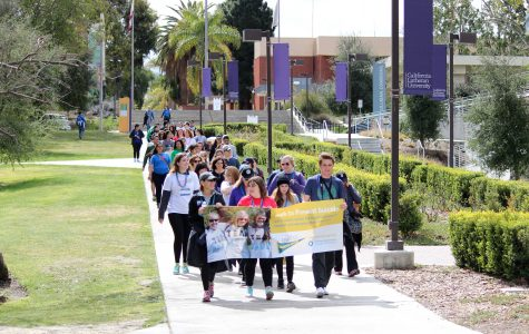 """Light in the darkness: Out of the Darkness participants walk to raise suicide prevention awareness and chant """"#stopsuicide"""" as they walk through the Cal Lutheran campus and surrounding neighborhood. Photo by Rachel Holroyd- Photojournalist"""
