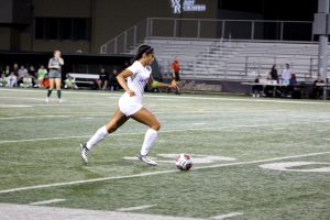 Sophomore defender Trinity Martinez takes advantage of open space as she dribbles towards Claremont's goal.  Photo by Brooke Stanley- Sports Editor