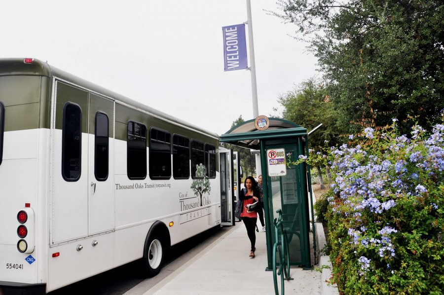 The daily commute: Second-year students Katherine Orantes and Valeria Flores exit the bus arriving from Newbury Park for early-morning classes. (Photo by Francisco Atkinson - Photojournalist)
