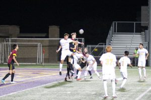 Senior Alex Cortez jumps up for a header against a defender in front of the CMS goal. The Kingsmen fell short to the Staggs on Wednesday 2-0. Photo by Ally Gaskill - Photojournalist