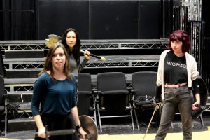 "Ready for battle: Cast members of ""She Kills Monsters"" (left to right) Megan Rackley, Moriah Sittner and Kylie ""Red"" Patterson rehearse one of the fight scenes set in the fantasy world of Dungeons and Dragons.  Photo by Jovani Garcia-photojournalist"