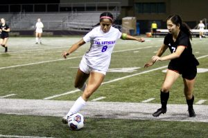 Sophomore defender Trinity Martinez goes up against Occidental senior midfielder Katherine Kim. The Regals and Tigers battled for 110 minutes, before ending the game in a scoreless tie.  Photo by Christie Kurdys - Photo Journalist
