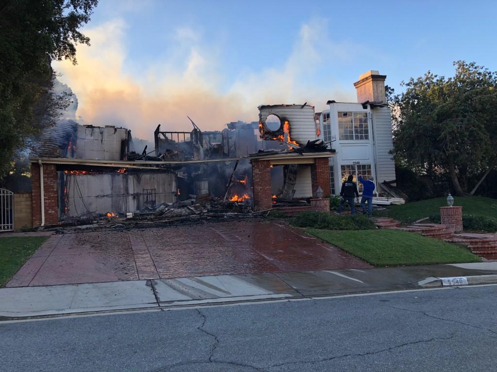 A home in Oak Park, California caught flames in the Woolsey Fire. - Photo provided by Arianna Macaluso