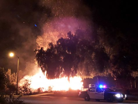 Ventura County emergency officials say they have adapted evacuation procedures to ensure residents are protected against COVID-19. Pictured: An Oak Park residence is engulfed in flames after the Woolsey Fire jumped across Highway 101 Nov. 9, 2018. File Photo by Paul Macaluso