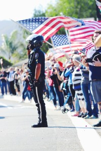 The aftermath: Ventura County Police salute in the memorial procession for Ventura County Sheriff's Deputy Sgt. Ron Helus Nov. 8.  Photo by Arianna Macaluso - Photo Editor