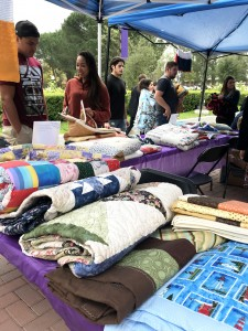 Quilted with care: Over 170 hand-made blankets, quilts and shawls were sent to Cal Lutheran from across the country to show support for the campus. They will be distributed again Dec. 4 and 5.  Photo provided by Jordan Castro.