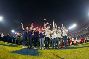 The Cal Lutheran Quartet waves to a crowd of over 70,000 after singing the national anthem on Monday, Nov. 19 at the Los Angeles Memorial Coliseum. Photo by the LA Rams, provided by Karin Grennan- California Lutheran University Media Relations Manager