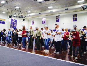Dodger players, first responders and Borderline families and survivors line dance a routine taught by Victoria Rose Meek.  Photo by Arianna Macaluso - Photo Editor