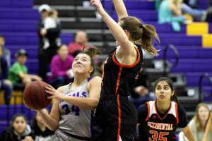 Junior forward Abi Torres-Drozd goes up against an Occidental defender in this file photo from the Regals' Feb. 2 victory against Occidental College.  After the Feb. 2 win and a Feb. 9 loss to Pomona-Pitzer, the Regals sit at sixth in the SCIAC with a record of 6-8, tied with the University of Redlands' 6-8 record.  (Photo by Gabby Flores - Photojournalist)