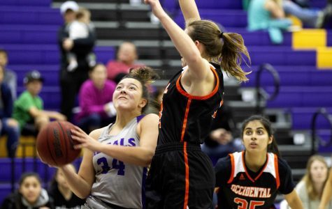 Regals Basketball Fights for Playoff Spot