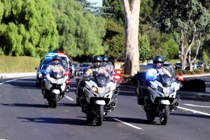 In memoriam: A motorcade led by Ventura County Sheriff's officers travels west on Lynn Road toward Highway 101 in honor of Sgt. Ron Helus. Photo by Arianna Macaluso - Photo Editor