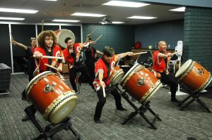 The Jishin Taiko Ensemble from California State University, Northridge, shows off their traditional Japanese drumming skills at Cal Lutheran's World Fair. Photo by Katherine Lippert- Reporter.