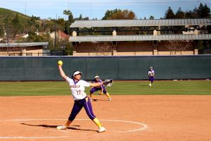 First-year pitcher Sammy Edmonds throws a heater of a fastball down the middle of home plate at Hutton Field. The Regals lost to the Claremont-Mudd-Scripps Athenas 9-6 in the first game of their double header and 10-0 in the second.  (Photo by Spencer Hardie)