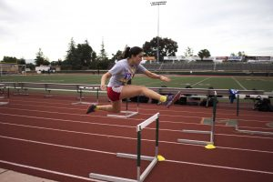 First-year hurdler Jasmine Rico practices her form during hurdles practice at the Moorpark High School track.  (Photo by Jessica Colby - Photojournalist)