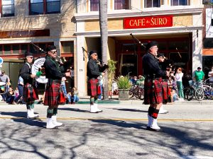 Luck of the Irish: A band of bagpipe players, clad in traditional Irish kilts and garb, pause as spectators look on.  Photo by James Alfaro - Reporter