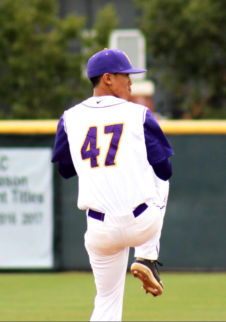 Senior left-handed pitcher Justin Fong gave up four hits in seven innings and pitched five perfect innings during the March 1 matchup against the Bulldogs. Despite letting in two runs, the pitcher struck out nine of Texas Lutheran's batters.  (Photo by Spencer Hardie - Photojournalist)