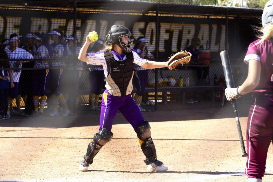 During the Regals' doubleheader against the Bulldogs, junior catcher Lexie Findley totaled one hit and one run, including a single off a bunt.  (Photo by Gabby Flores - Photojournalist)