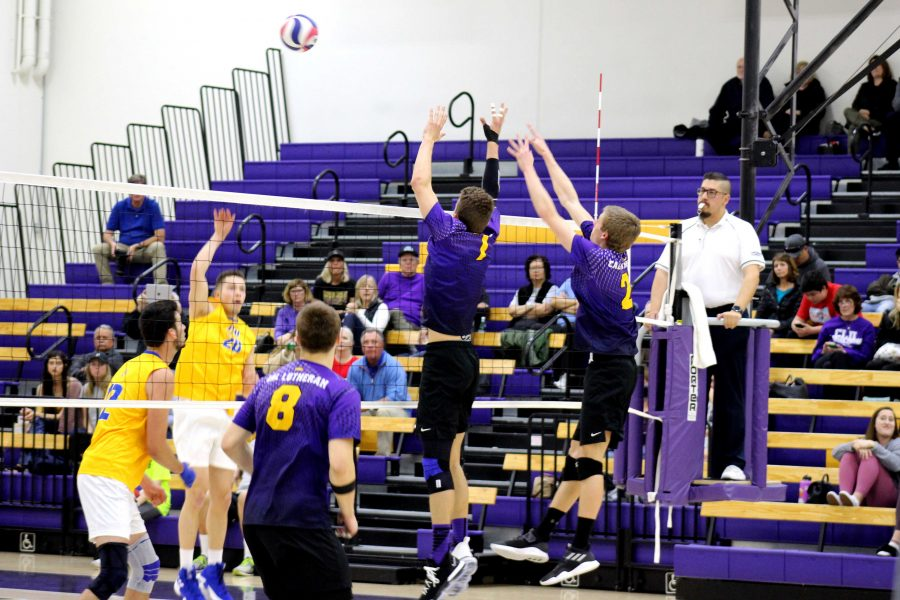 Senior opposite Brendan Ward and junior outside hitter Mason Mercer defend over the net against the Johnson & Wales University Bulldogs. After four wins in the Cal-Lu-Fornia Classic tournament, the Kingsmen are 9-7 on the season.  (Photo by Spencer Hardie - Photojournalist)