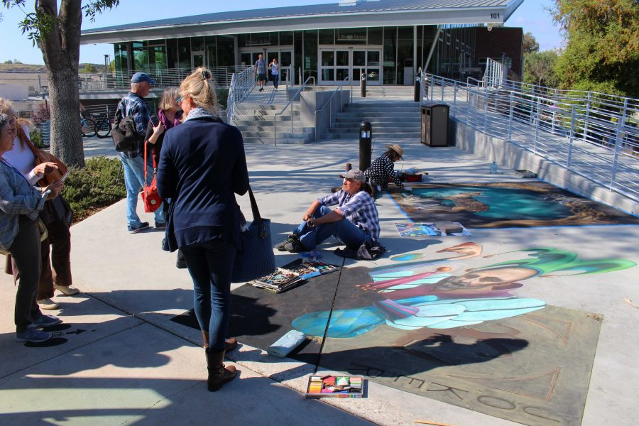 Attendees of the Representational Art Conference walk through the Chalk Festival on Cal Lutheran's campus on April 2. They also visited the Kwan Fong Gallery of Art and Culture and William Rolland Gallery of Fine Art on campus.  Photo by Spencer Hardie- Photojournalist.