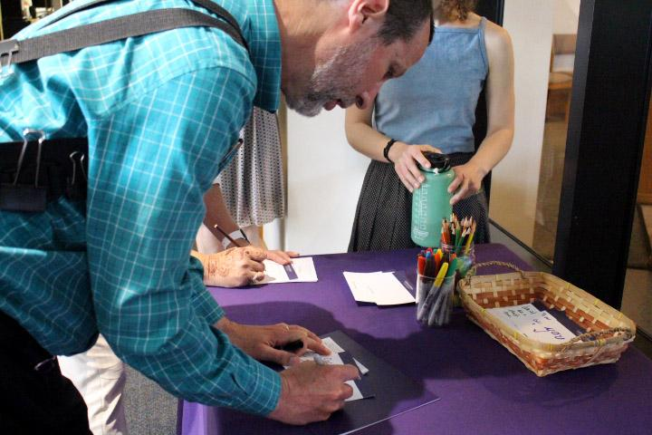 Come together: Chapel hours May 2 was dedicated to a service for Holocaust Remembrance Day. Students, faculty and Cal Lutheran community members wrote letters to pay respects to the nearly six million Jews who were killed during WWII. Photo by Jessica Colby - Photojournalist