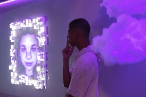 "Kiyoshi Taylor (pictured), Annabelle Worrall, and Andrew Tufenkian created ""The Purple Room,"" part of the multimedia capstone exhibit CLUFest ""Colors.""   Photo by Katie May- Photojournalist."