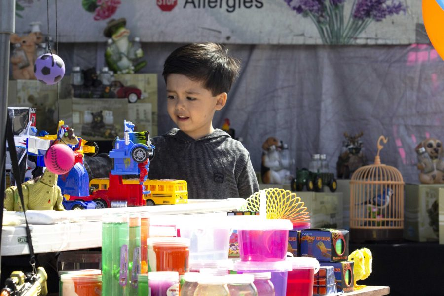 A fairly good time: In addition to crafts and games, children had the opportunity to play with toys of all sorts at entertainment booths throughout the quarter-mile stretch of fair grounds. Photo by Gabby Flores - Photojournalist